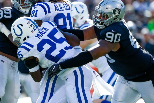 Oakland Raiders' Johnathan Hankins (90), right, tackles Indianapolis Colts' Marlon Mack (25), left, in the second quarter of their NFL game at the Coliseum in Oakland, Calif., on Sunday, Oct. 28, 2018. (Randy Vazquez/Bay Area News Group)