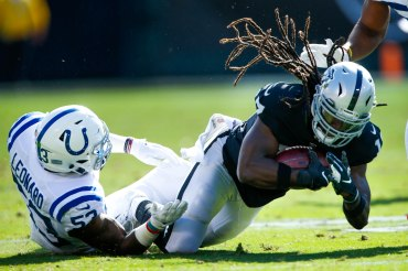 Oakland Raiders' Dwayne Harris (17), right, gets tackled by Indianapolis Colts' Darius Leonard (53), left, in the second quarter of their NFL game at the Coliseum in Oakland, Calif., on Sunday, Oct. 28, 2018. (Randy Vazquez/Bay Area News Group)