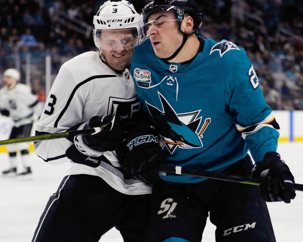 Los Angeles Kings' Dion Phaneuf (3), left, shoves San Jose Sharks' Timo Meier (28), right, during the first period of their game at SAP Center in San Jose, Calif., on Monday, Jan. 7, 2019. (Randy Vazquez/Bay Area News Group)