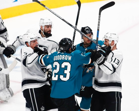 San Jose Sharks' Barclay Goodrow (23), center, gets between Los Angeles Kings players and his teammate during the second period of their game at SAP Center in San Jose, Calif., on Monday, Jan. 7, 2019. (Randy Vazquez/Bay Area News Group)