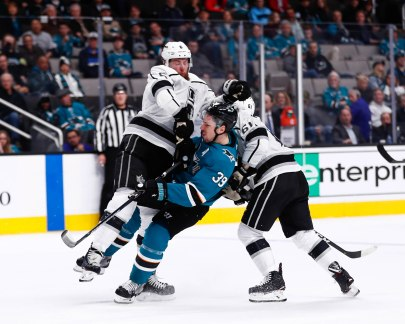 San Jose Sharks' Logan Couture (39) was open ice checked between Los Angeles Kings' Sean Walker (61), right, and teammate Jake Muzzin (6), left, during the third period of their game at SAP Center in San Jose, Calif., on Monday, Jan. 7, 2019. (Randy Vazquez/Bay Area News Group)
