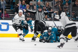 San Jose Sharks players look on as Los Angeles Kings' Jake Muzzin (6) takes a shot during the third period of their game at SAP Center in San Jose, Calif., on Monday, Jan. 7, 2019. (Randy Vazquez/Bay Area News Group)