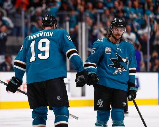San Jose Sharks' Joe Thornton (19), left, fist bumps teammate Erik Karlsson (65), right, after scoring versus the Los Angeles Kings during the third period of their game at SAP Center in San Jose, Calif., on Monday, Jan. 7, 2019. The Sharks would go on to win the game 3-1 versus the Kings. (Randy Vazquez/Bay Area News Group)