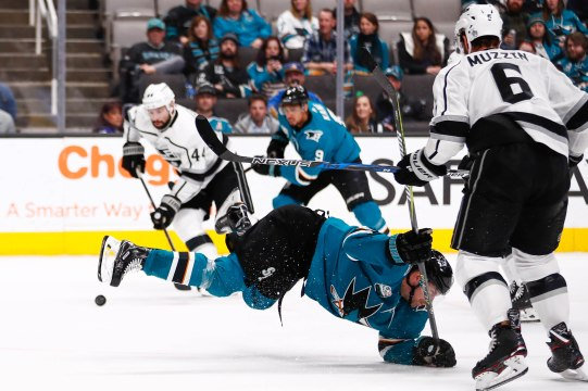 San Jose Sharks' Joonas Donskoi (27), center, falls down while attempting to get the puck during the third period of their game versus the Los Angeles Kings at SAP Center in San Jose, Calif., on Monday, Jan. 7, 2019. (Randy Vazquez/Bay Area News Group)