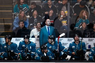 San Jose Sharks head coach Peter DeBoer, center, looks up during the second period of his teams game versus the Los Angeles Kings at SAP Center in San Jose, Calif., on Monday, Jan. 7, 2019. (Randy Vazquez/Bay Area News Group)
