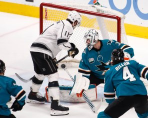 Los Angeles Kings captain Anze Kopitar (11), left, scores on San Jose Sharks' Martin Jones (31), center, during the second period of their game at SAP Center in San Jose, Calif., on Monday, Jan. 7, 2019. (Randy Vazquez/Bay Area News Group)
