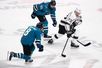 Los Angeles Kings' Tyler Toffoli (73), right, tries to skate away San Jose Sharks captain Joe Pavelski (8), left, and teammate Erik Karlsson (65), center, during the second period of their game at SAP Center in San Jose, Calif., on Monday, Jan. 7, 2019. (Randy Vazquez/Bay Area News Group)