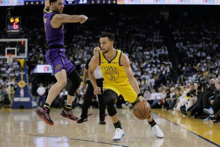 Golden State Warriors' Stephen Curry (30), right, dribbles passed Los Angeles Lakers' Lonzo Ball (2), left, during the first quarter of their game at Oracle Arena in Oakland, Calif., on Tuesday, Dec. 25, 2018. (Randy Vazquez/Bay Area News Group)