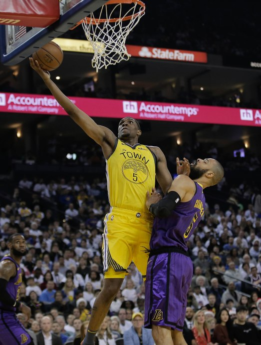 Golden State Warriors' Kevon Looney (5), left, scores a layup while being guarded by Los Angeles Lakers' Tyson Chandler (5), right, during the first quarter of their game at Oracle Arena in Oakland, Calif., on Tuesday, Dec. 25, 2018. (Randy Vazquez/Bay Area News Group)