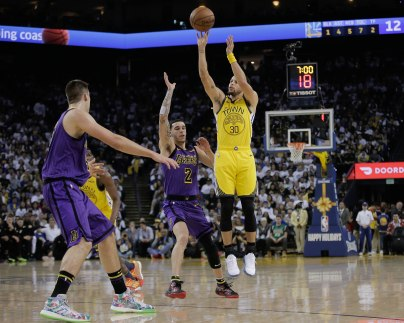 Golden State Warriors' Stephen Curry (30), right, takes a shot over Los Angeles Lakers' Lonzo Ball (2), center, during the first quarter of their game at Oracle Arena in Oakland, Calif., on Tuesday, Dec. 25, 2018. (Randy Vazquez/Bay Area News Group)