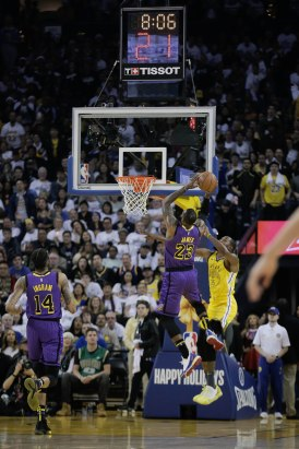 Los Angeles Lakers' LeBron James (23), center, drives to the basket while guarded by Golden State Warriors' Kevin Durant (35), right, during the first quarter of their game at Oracle Arena in Oakland, Calif., on Tuesday, Dec. 25, 2018. (Randy Vazquez/Bay Area News Group)