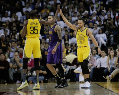 Golden State Warriors' Stephen Curry (30), right, gives teammate Kevin Durant (35), right, a high five after being fouled during the third quarter of their game versus the Los Angeles Lakers at Oracle Arena in Oakland, Calif., on Tuesday, Dec. 25, 2018. (Randy Vazquez/Bay Area News Group)