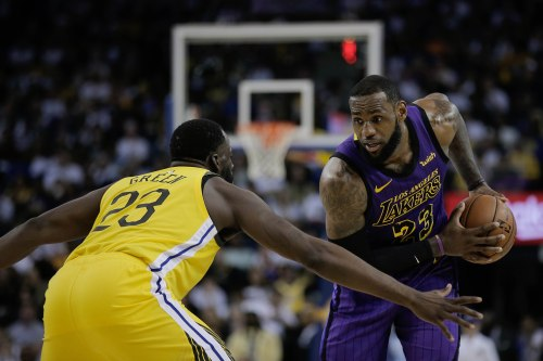 Los Angeles Lakers' LeBron James (23), right, is guarded by Golden State Warriors' Draymond Green (23), left, during the third quarter of their game at Oracle Arena in Oakland, Calif., on Tuesday, Dec. 25, 2018. (Randy Vazquez/Bay Area News Group)