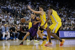 Los Angeles Lakers' Lonzo Ball (2), left, dribbles passed Golden State Warriors' Klay Thompson (11), center, during the third quarter of their game at Oracle Arena in Oakland, Calif., on Tuesday, Dec. 25, 2018. (Randy Vazquez/Bay Area News Group)