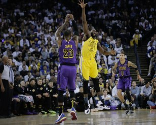 Los Angeles Lakers' LeBron James (23), left, makes a pass over Golden State Warriors' Draymond Green (23) during the first quarter of their game at Oracle Arena in Oakland, Calif., on Tuesday, Dec. 25, 2018. (Randy Vazquez/Bay Area News Group)