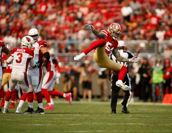 San Francisco 49ers' Cassius Marsh (54) celebrates after sacking Arizona Cardinals starting quarterback Josh Rosen (3) in the second quarter of their game at Levi's Stadium in Santa Clara, Calif., on Sunday, Oct. 7, 2018.(Randy Vazquez/Bay Area News Group)