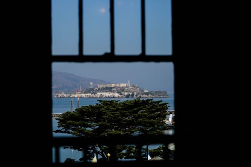 Alcatraz Island is seen through a window at The Cheese School of San Francisco on Thursday, Oct. 18, 2018. (Randy Vazquez/Bay Area News Group)