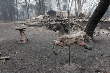 A carousel horse horse is photographed in front of the home of Ernest Foss in Paradise, Calif., on Tuesday, Nov. 13, 2018. Foss, who grew up in the Bay Area, was one of the victims of the Camp Fire. (Randy Vazquez/Bay Area News Group)