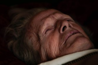 Norma Weldon, 90, lays in bed in her son Brad's home in Paradise, Calif., on Monday, Nov. 12, 2018. Brad and friend Michiel McCrary chose not to evacuate during the Camp Fire and fought off flames and kept Brad's home and his mother safe. (Randy Vazquez/Bay Area News Group)