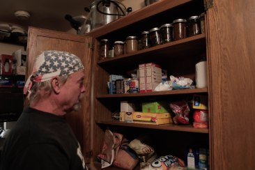 Brad Weldon opens his cabinet with supplies in his home in Paradise, Calif., on Monday, Nov. 12, 2018. Weldon and friend Michiel McCrary chose not to evacuate during the Camp Fire and fought off flames and kept Brad's home and his 90-year-old mother safe. (Randy Vazquez/Bay Area News Group)