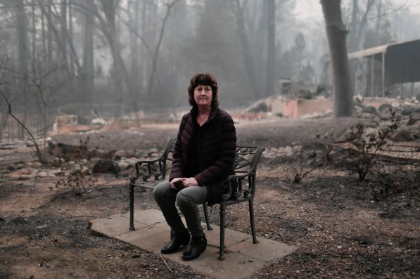 Mayor Jody Jones sits on a bench in the front yard of her home in Paradise, Calif., on Wednesday, Nov. 14, 2018. Her house was burned during the Camp Fire last week. (Randy Vazquez/Bay Area News Group)