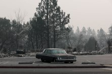 A vehicle is photographed in Paradise, Calif., on Thursday, Nov. 15, 2018. The car received little damage during the Camp Fire. However the structures around it were destroyed. (Randy Vazquez/Bay Area News Group)