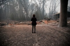 Mayor Jody Jones takes a picture of where her house used to be in Paradise, Calif., on Wednesday, Nov. 14, 2018. Her house was burned during the Camp Fire last week. (Randy Vazquez/Bay Area News Group)