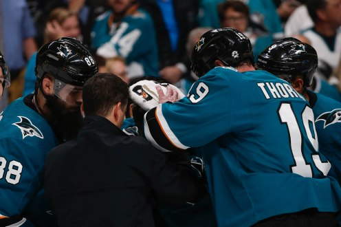 SAN JOSE, CA - APRIL 23: San Jose Sharks' Joe Thornton (19), right, appears to covers up teammate Joe Pavelski's (8) injury in the third period of Game 7 of their NHL first round playoff series versus the Vegas Golden Knights at the SAP Center in San Jose, Calif., on Tuesday, April 23, 2019. (Randy Vazquez/Bay Area News Group)