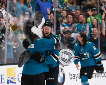 SAN JOSE, CA - APRIL 23: San Jose Sharks' Tomas Hertl (48), center, hugs SJ Sharkie after the teams overtime win over the Vegas Golden Knights in Game 7 of their NHL first round playoff series at the SAP Center in San Jose, Calif., on Tuesday, April 23, 2019. (Randy Vazquez/Bay Area News Group)