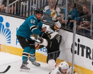 SAN JOSE, CA - APRIL 23: San Jose Sharks' Kevin Labanc (62), left, slams Vegas Golden Knights' Colin Miller (6), right, into the glass in the first period of Game 7 of their NHL first round playoff series at the SAP Center in San Jose, Calif., on Tuesday, April 23, 2019. (Randy Vazquez/Bay Area News Group)