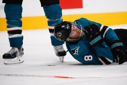 SAN JOSE, CA - APRIL 23: San Jose Sharks' Joe Pavelski (8), right, lays on the ground after apparently being hit in the head in the third period of Game 7 of their NHL first round playoff series versus the Vegas Golden Knights at the SAP Center in San Jose, Calif., on Tuesday, April 23, 2019. (Randy Vazquez/Bay Area News Group)