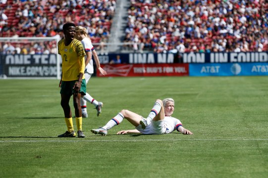 United states forward Megan Rapinoe (15), right, looks at the referee after being tripped up during the second half of their friendly game versus South Africa at Levi's Stadium in Santa Clara, Calf., on Sunday, May 12, 2019. (Randy Vazquez/Bay Area News Group)
