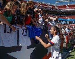 United States forward Alex Morgan (13), right, signs autographs for fans after her teams friendly game versus South Africa at Levi's Stadium in Santa Clara, Calf., on Sunday, May 12, 2019. The United States would win the game 3-0 over South Africa. (Randy Vazquez/Bay Area News Group)