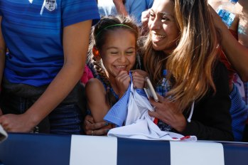 A young fan smiles after getting an autograph from United States forward Alex Morgan (13) after the teams game versus South Africa at Levi's Stadium in Santa Clara, Calf., on Sunday, May 12, 2019. The United States would win the game 3-0 over South Africa. (Randy Vazquez/Bay Area News Group)