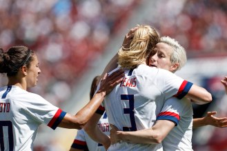 United States midfielder Samantha Mewis (3), center, is hugged by teammate Megan Rapinoe (15), right, after scoring during the second half of their friendly game at Levi's Stadium in Santa Clara, Calf., on Sunday, May 12, 2019. (Randy Vazquez/Bay Area News Group)