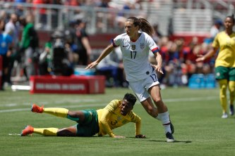 United States forward Tobin Heath (17), right, gets around South Africa's Nothando Vilakazi (3), left, during the first half of their friendly game at Levi's Stadium in Santa Clara, Calf., on Sunday, May 12, 2019. (Randy Vazquez/Bay Area News Group)