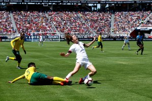 United States defender Kelley O'Hara (5), center, falls down after receiving contact from South Africa's Nothando Vilakazi (3), left, during the first half of their friendly game at Levi's Stadium in Santa Clara, Calf., on Sunday, May 12, 2019. (Randy Vazquez/Bay Area News Group)
