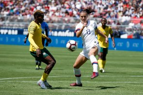 United States forward Alex Morgan (13), right, tries to control the ball while being defended by South Africa's Noko Matlou (4), left, defender during the first half of their friendly game at Levi's Stadium in Santa Clara, Calf., on Sunday, May 12, 2019. (Randy Vazquez/Bay Area News Group)