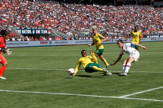 United States forward Carli Lloyd (10), right, scores a goal while being defended by South Africa's Bambanani Mbane (13), center, during the second half of their friendly game at Levi's Stadium in Santa Clara, Calf., on Sunday, May 12, 2019. (Randy Vazquez/Bay Area News Group)