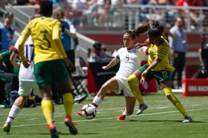 United States defender Kelley O'Hara (5), center, tries to make a pass while being defended by South Africa's Jermaine Seoposenwe (12), right, during the first half of their friendly game at Levi's Stadium in Santa Clara, Calf., on Sunday, May 12, 2019. (Randy Vazquez/Bay Area News Group)