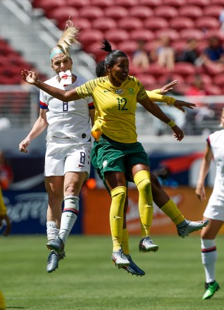 United States midfielder Julie Ertz (8), left, jumps for a header with South Africa's Jermaine Seoposenwe (12), right, during the first half of their friendly game at Levi's Stadium in Santa Clara, Calf., on Sunday, May 12, 2019. Ertz appeared to have suffered an injury in her mouth area. (Randy Vazquez/Bay Area News Group)