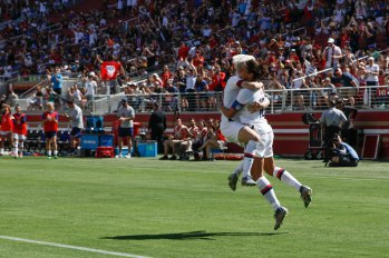 United States forward Carli Lloyd (10), right, celebrates after scoring with teammate Megan Rapinoe (15), center, during the second half of their friendly game versus South Africa at Levi's Stadium in Santa Clara, Calf., on Sunday, May 12, 2019. (Randy Vazquez/Bay Area News Group)