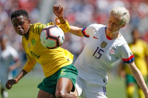 South Africa's Lebohang Ramalepe (2), left, and United States forward Megan Rapinoe (15), right, go after a ball during the second half of their friendly game at Levi's Stadium in Santa Clara, Calf., on Sunday, May 12, 2019. The United State would win the game 3-0 over South Africa. (Randy Vazquez/Bay Area News Group)
