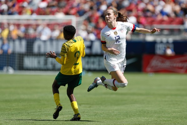 United States defender Tierna Davidson (12), right, leaps around South Africa's Lebohang Ramalepe (2), left, during the second half of their friendly game at Levi's Stadium in Santa Clara, Calf., on Sunday, May 12, 2019. (Randy Vazquez/Bay Area News Group)