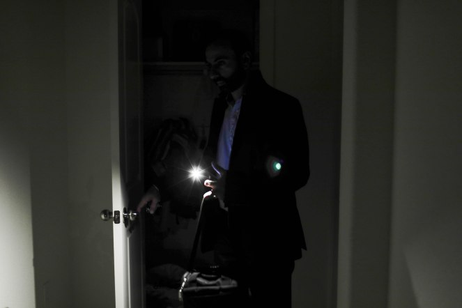 Davinder Sohal, uses the light from his cell phone to navigate around his home in the River Island community in Lathrop, Calif., on Monday, Oct. 1, 2018. Sohal is one of thousands of people who make the commute from the Central Valley to the Bay Area for work. Sohal leaves his home around 3:30 a.m. to avoid traffic. (Randy Vazquez/Bay Area News Group)