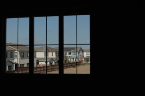 Homes are seen through the window of a model home in the River Island community in Lathrop, Calif., on Sunday, Sep. 30, 2018. (Randy Vazquez/Bay Area News Group)