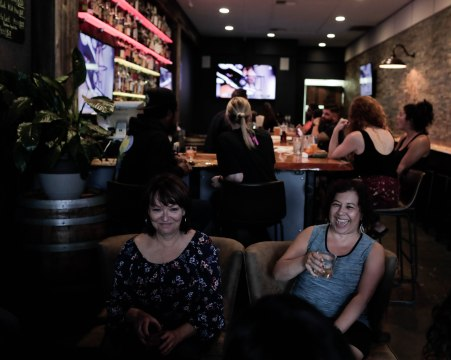 Tess Ramos-Cruz, right, laughs while having a drink with Christine Perio, left, at Purgatory Craft Beer & Whiskey Bar in Tracy, Calif., on Sunday, Sep. 30, 2018. (Randy Vazquez/Bay Area News Group)