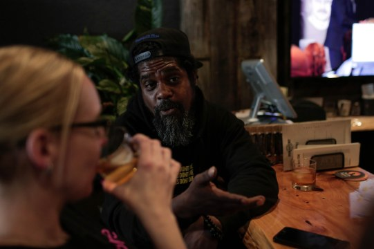 James Winters, center, has a drink at Purgatory Craft Beer & Whiskey Bar in Tracy, Calif., on Sunday, Sep. 30, 2018. (Randy Vazquez/Bay Area News Group)