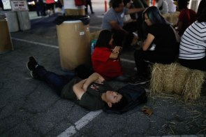 Jonathan Ho, 17, rest as he and his family wait for a ride at a reunification center at Gavilan College in Gilroy, Calif., on Sunday, July 28, 2019. People were directed to the center following a shooting at the Gilroy Garlic Festival. (Randy Vazquez/Bay Area News Group)
