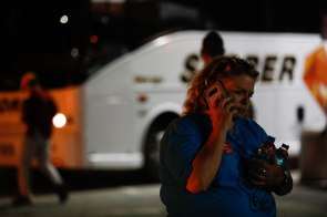 Tammy Stone talks on the phone at a reunification center at Gavilan College in Gilroy, Calif., on Sunday, July 28, 2019. People were directed to the center following a shooting at the Gilroy Garlic Festival. (Randy Vazquez/Bay Area News Group)